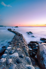Dusk at Stone Jetty (-TommyTsutsui- [nextBlessing]) Tags: longexposure blue light sunset sea orange seascape yellow rock japan landscape nikon purple dusk jetty magic tide scenic wave     izu earlysummer toi     sigma1020    onsalegettyimages
