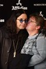 Ozzy Osbourne meets and poses with fans who bought T-shirts from the Affliction line he and wife Sharon designed for Nordstrom's Tysons Corner, Virginia