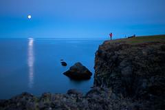 Two taking pictures (Satli) Tags: ocean sea sun moon reflection photography iceland rocks photographer cliffs midnight moonlight takingpictures arnarstapi snfellsnes satli allrightsreservedc
