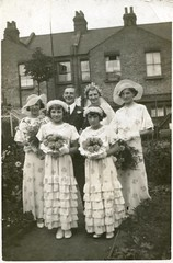 1930s Wedding Group (TempusVolat) Tags: flowers houses wedding fashion vintage groom bride thirties 1930s interesting scans flickr dress mr image scanner picture hats scan bridesmaids dresses scanned bridesmaid getty epson scanning gw gareth perfection tempus v200 terraced morodo epsonscanner houseback photoscanner epsonperfection volat mrmorodo garethwonfor tempusvolat