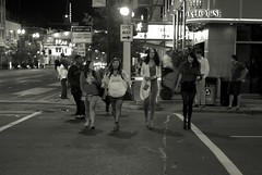 Girls crossing street L1100020 (erlin1) Tags: 40mmnokton 2012 august august2012 leicam8 minneapolis night nighttime streetphotography v1 mn usa v1bw blackandwhite