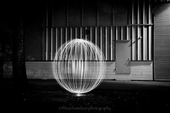 light years (bluechameleon) Tags: city light urban blackandwhite bw building lines vancouver empty orbit circular whitelight bluechameleon sharonwish circularlight bluechameleonphotography