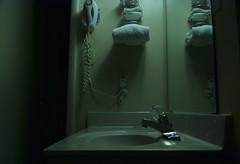 (Hunter McGinnis) Tags: blue shadow stilllife dark bathroom hotel noir grain motel scene conceptual