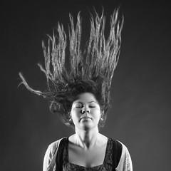 Muse #4 (NoraFL) Tags: lighting portrait hair studio blackwhite escape surrealism dream surreal dreaming muse dreads daydream throw absorbed rastafari reverie psychological canon5dmark2