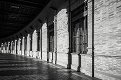 Repetition #2 (BoXed_FisH) Tags: plaza travel sunset shadow blackandwhite bw building monochrome architecture square grey mono sevilla andaluca spain sony wideangle monotone seville unesco repetition es movieset archtitecture plazadeespana attackoftheclones placesofinterest sonyalpha sonyzeiss zeiss1635 sonya7 sel1635z sony1635mmvariotessartfef4zaoss sonyzeiss1635f4oss