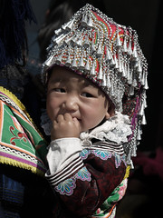 Portrait of a sweet Baby with traditional tribal clothes, Yunnan, Chin a (magbrinik) Tags: china travel portraits children tribes yunnan guizhou motherhood kiddies traditionaldress hilltribes nationalgeographic traditionalvillage travelphotography kidsportrait silverjewellery trib kidportrait southestasia tribalportrait childeyes traditionallife ruralportrait portraiturephotography portraitoftheworld travelreportage remoteregion