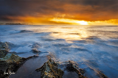heavy light ([Adam Baker]) Tags: ocean sunset motion mountains reflection beach water canon landscape hawaii waves pacific crash north shore tropical reef haleiwa 1740l adambaker 5dmkii