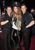 Roz Purcell with Leo and Chico of male strip group The Chain Gang Hush nightclub at the Red Cow Complex celebrates it's 5th birthday Dublin, Ireland