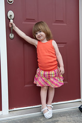 June 22, 2012_11 (Kim_Reimer) Tags: door pink red baby canada silly color cute girl childhood handle kid toddler child bc outdoor britishcolumbia daughter adorable posing skirt innocence tanktop northamerica carefree 2yearsold sleeveless gettyimagescanada