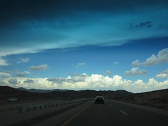 On the other side   ...   after the storm (mmcgin452) Tags: blue sky clouds drive highway roadtrip