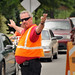 Transportation employee directs traffic at the Cates and Dan Allen intersection during Friday's move-in.MOVEIN.2012.1594