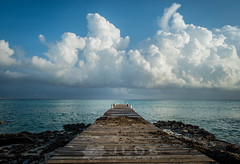 Pier1 (Jim   jld3 photography) Tags: ocean old blue sea white clouds composition point islands coast pier nikon decay central perspective calming grand calm cumulus cayman 24mm simple vanishing puffy linear d800 caymans pleasing 14g f14g