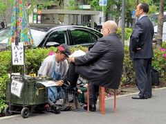 Tokyo (veronicajwilliams photography) Tags: travel man men japan businessman tokyo shoeshine businessmen travelphotography veronicajwilliams veronicajwilliamsphotography