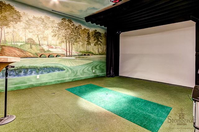 In honor of the MASTERS GOLF TOURNAMENT this week check out this golf simulator room complete with hand painted murals of Augusta National.