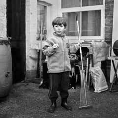Helping hand (ted.kozak) Tags: boy portrait bw 120 6x6 film monochrome garden square explore rake olly rodinal 100iso kozak bronicasqa explored gustas zenzanonps80mmf28 shanghaigp3100 tedkozak tadaskazakevicius wwwtedkozakcom