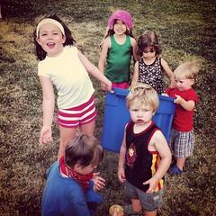 Kids getting water balloons at picnic