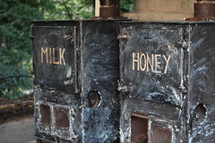 Milk and honey (Joybot) Tags: old greatbritain england black dusty canon vintage milk iron oven unitedkingdom britain dirty devon honey stove retreat heater disused dslr range exmoor lynton poele leeabbey 600d