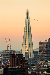 London - Beefing Up Security at The Shard Air Space (Yen Baet) Tags: city uk greatbritain trip travel sunset england urban panorama building london millenniumwheel skyline architecture modern londonbridge river photography photo cosmopolitan europe european cityscape view skyscrapers unitedkingdom britain dusk postcard scenic eu landmark icon tourists structure southbank british picturesque iconic riverthames metropolitan thamesriver spectacle london2012 britons wetsminster theshard yenbaet