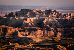 Shining city on a hill (coneslayer) Tags: rockformations sun sunset smcpda300mmf4edifsdm badlandsnationalpark southdakota unitedstates