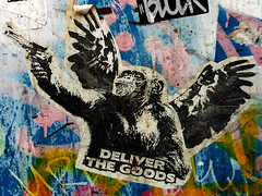 Deliver The Goods (~db~) Tags: california urban usa streetart art colors america writing graffiti la words losangeles wings sticker paint gun grafitti unitedstates chimp grafiti text letters stickers socal hollywood graffitti ape publicart hollywoodblvd deliver fullofcolors s6100100dscn3703