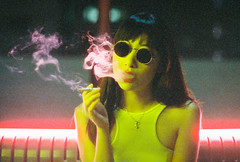 What Brought You Back Here? (Jon Siegel) Tags: pink light woman sexy film rooftop girl beautiful sunglasses yellow mystery night asian 50mm iso800 evening nikon singapore neon moody smoke chinese scene smoking mysterious redlipstick 12 nikkor cinematography cinematic wongkarwai fe2 nikon50mmf12 cinestill christopherdoyleinspired