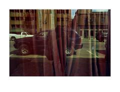 Red curtain, white truck, blue SUV (Richard C. Johnson: AKA fishwrapcomix) Tags: white reflection film window minnesota analog restaurant border grain chinese ishootfilm storefront analogue duluth endofempire fujifilmsuperia400 scanfromnegative sunrisesintheeast elmarit28mm leicar8 sunsetsinthewest economicdownturn civisromanussum thegreatrecession paxamericanus keeptheindustryalive dontuseexpiredfilm usefreshfilm