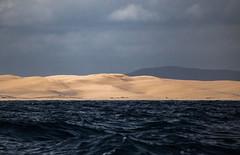 Stockton Beach (robertdownie) Tags: ocean new sky beach water wales clouds river dark sand waves crash dunes south australia shipwreck nsw hunter stockton ominious