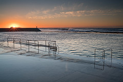 Wave in front of the sun (noompty) Tags: ocean sunrise newcastle surf pentax baths nsw k1 carlzeiss zk distagont235 on1pics