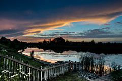 The fence to the evening (marielledevalk) Tags: sky cloud water skyline fence landscape waterfront outdoor hff fencedfriday