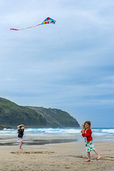 Why let a blustery day spoil your time at the seaside? (Craig Skinner - www.craigskinnerphotography.co.uk) Tags: uk family sea sky cliff holiday kite beach kids fun 50mm coast fly seaside nikon cornwall play cornish kernow perranporth d7100