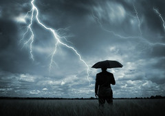 Caught in the Storm (raptor_witness) Tags: sky storm male men green nature field grass businessman standing umbrella outdoors freedom holding open adult space meadow safety business suit below safe lightning rearview ideas success protection thunder insurance oneperson concepts occupation covering colorimage environmentalconservation leisureactivity shielding employmentissues businessperson weathershelter