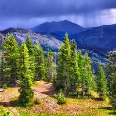 To Touch The Earth ... (Aspenbreeze) Tags: sunlight storm mountains nature rain clouds colorado peaks crestedbutte summerstorm thegalaxy crestedbuttecolorado mountainstorm aspenbreeze