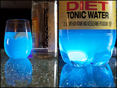 Get Your Glow On... (lynn.h.armstrong) Tags: camera blue light red ontario canada black reflection art water glass yellow lens table geotagged photography photo bottle interesting mac aperture nikon diptych long flickr glow purple zoom room south bubbles images plastic lynn h fluorescent getty dining lime diet nikkor gin armstrong ultraviolet tonic stormont vr licence afs request gordons dx sault attribution ingleside ifed 18200mm quinine f3556 noderivs vrii d7000 lynnharmstrong