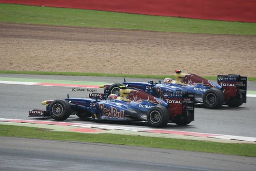 Red Bull Racing Drivers Mark Webber and Sebastian Vettel celebrate after the 2012 British Grand Prix at Silverstone