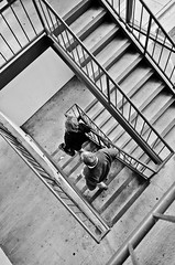 Going Down (Lea and Luna) Tags: people blackandwhite bw monochrome stairs walking md nikon parkinggarage walk garage steps maryland nikkor lr frederick lightroom stariwell adifferentpointofview achromatic differentpov d5100 55300mmf45