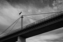 Carrying the country (Trace Connolly) Tags: road bridge sky blackandwhite bw flag bridges australia melbourne trucks trucking westgatebridge australianflag yarrariver monochromephotography canon7d