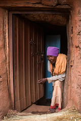 Old woman monk in her small house, Amhara region, Lalibela, Ethiopia (Eric Lafforgue) Tags: africa door people house color vertical religious outdoors photography clothing women day adult african faith religion christian unescoworldheritagesite devotion christianity shawl spirituality ethiopia orthodox worshipper religiouscelebration oneperson developingcountry lalibela orthodoxy hornofafrica ethiopian eastafrica thiopien etiopia abyssinia ethiopie traditionalclothing realpeople etiopa ruralscene fulllenght  etiopija africanethnicity 1people ethiopi  africanculture etiopien etipia  etiyopya  oneseniorwomanonly amhararegion      oneadultonly    ethio163741