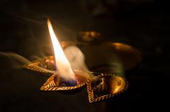 Faith (arkodeepsen) Tags: india hot yellow festival fire nikon smoke faith culture kolkata puja durgapuja aarti bengali diya bangali d5100