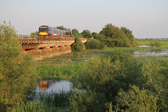 170117 on the Ouse Washes, Cambridgeshire (Julian Hodgson) Tags: train flood rail railway crosscountry fens cambridgeshire fenland flooded dmu networkrail class170 manea hundredfootwashes ousewashes crosscountrytrains