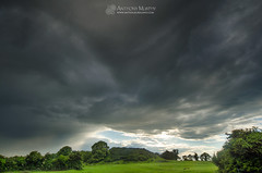 Dark sky over Dowth (mythicalireland) Tags: trees ireland summer sky irish sun monument clouds dark landscape outdoors evening valley myth boyne passagetomb dowth brnabinne passagemound