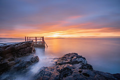 Few seconds before the sunrise at Portmarnock, Dublin (Wojtek Piatek) Tags: ocean ireland sea dublin irish seascape clouds zeiss sunrise landscape golden coast rocks long exposure sony filter lee nd hours 1635 a99 sonyflickraward