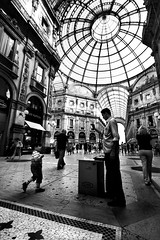 . (Nicol Panzeri) Tags: people blackandwhite bw italy milan monochrome canon person italia child gente interior milano streetphotography wideangle monotone bn persone inside grandangolo lombardia octagon biancoenero 1022 hawker interno streetshot lombardy bambino canon1022 galleriavittorioemanueleii ottagono venditoreambulante canon450d scattodistrada scattocittadino nicolpanzeri