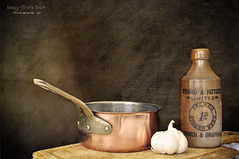 Copper pan, garlic, vintage bottle and my every day cutting board (Nancy Violeta Velez) Tags: stilllife texture photography interesting flickr antique motat nikkor18200 stewardpatteson tatot nikond5000 frenchkissartisteatelier brewedgingerbeernorwichswaffham nancyvioletavelez~photographicart copperpangarlicvintagebottleandmyeverydaycuttingboard crosbystillsnashyoungourhouse