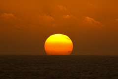 Sunset over Lanzarote (Keith in Southampton) Tags: las sunset sun beach ball fire volcano islands spain horizon lanzarote playa canarias el steam craters blanca crater canary volcanoes volcanic canaries golfo espania