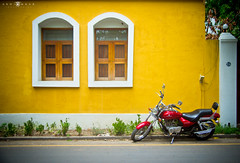 Pondicherry Colony (abhiomkar) Tags: park door windows red india france beach colors bike yellow wall french colorful parked colony pondicherry bajaj avenger pondy