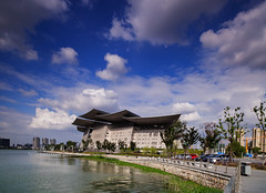 Wuxi Grand Theatre () Tags: china sunset summer sky people cloud lake nature water architecture canon landscape wuxi wideangle sunsetglow   typhoon  ze   carlzeiss    taihulake  canoneos5dmarkii distagont2821 eos5dmarkii ze2128   gettychinaq3 lihubridge wuxigrandtheatre