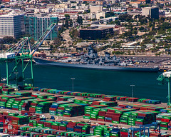 Iowa among the Containers (*PhotoByJohn*) Tags: california losangeles other aerial helicopter evergreen battleship aerialphotography sanpedro robinsonr22 shippingcontainers portoflosangeles ussiowa losangelesharbor iowaclass containercrane bb61 canon40d evergreenmarine