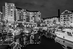 Chelsea (andrejsf) Tags: uk bw white black reflection london night canon boats long exposure chelsea harbour yacht sigma gb f28 1750mm 450d vision:outdoor=09