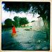 Woman On The Street Wearing A Red Hood,  Boorama, Somaliland