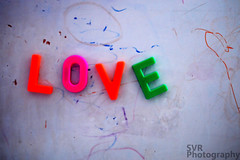 Love is all you need (SVR21) Tags: pink orange color green love photography colorful colours letters whiteboard magnets colourful